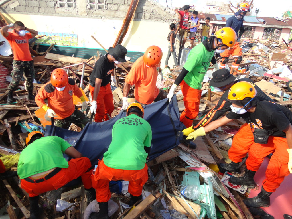 Lifting the Dead. Rescuers of Team Albay doing retrieval operation in Tacloban City.