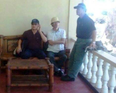 The victim's son Abby [sitting in white with a hat] with Korean Embassy official inside Camp Teodulfo Bautista in Jolo, Sulu. [Photo by JTG-SULU]