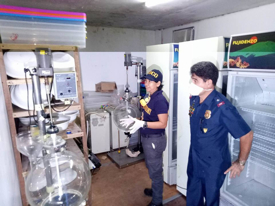 Shabu Laboratory in the Island. Police Chief Superinetndent Melvin Ramon G. Buenafe, Regional Director of Police Regional Office – 5 looks on the laboratory equipments. A photo grab from PNP PRO-5 Press Corps post by Ramil D. Soliveres.
