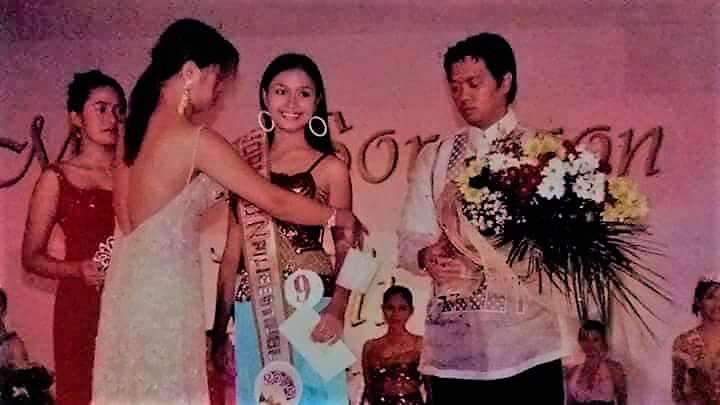 The first crowned Miss Pili Festival 2004, Jona Lou V. Lanuza [center] with Governor Robert Lee Rodrigueza. Photo courtesy by Edgar Tumangan.