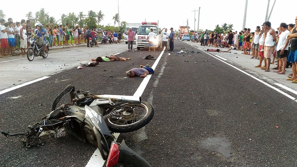 A tragic scene on the road at dusk along Purok 1, Barangay Cabunturan, Malinao, Albay. Photo by Malinao Municipal Police Station.