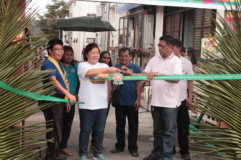 The Guinobatan Longganisa Festival 2017 Agri-Fair Opening.From [left] DTI - Albay Provincial Director Rodrigo Aguilar, [center] Mayor Ann Yap Ongjoco, Albay and Municipal Councilor Wilfredo O. Arevalo. www.philexaminer.com photo.