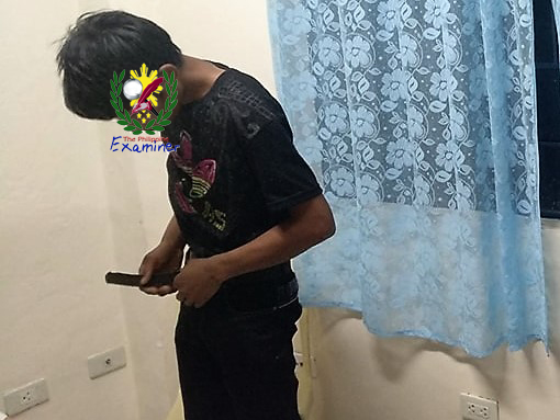 The suspect, Arturo Timbal y Dela Torre, 25 years old, abaca stripper, single has voluntarily surrendered to the village officials of Barangay P. Vera and was place under arrest subsequently by Viga Police. Photo by Viga Municipal Police Station.