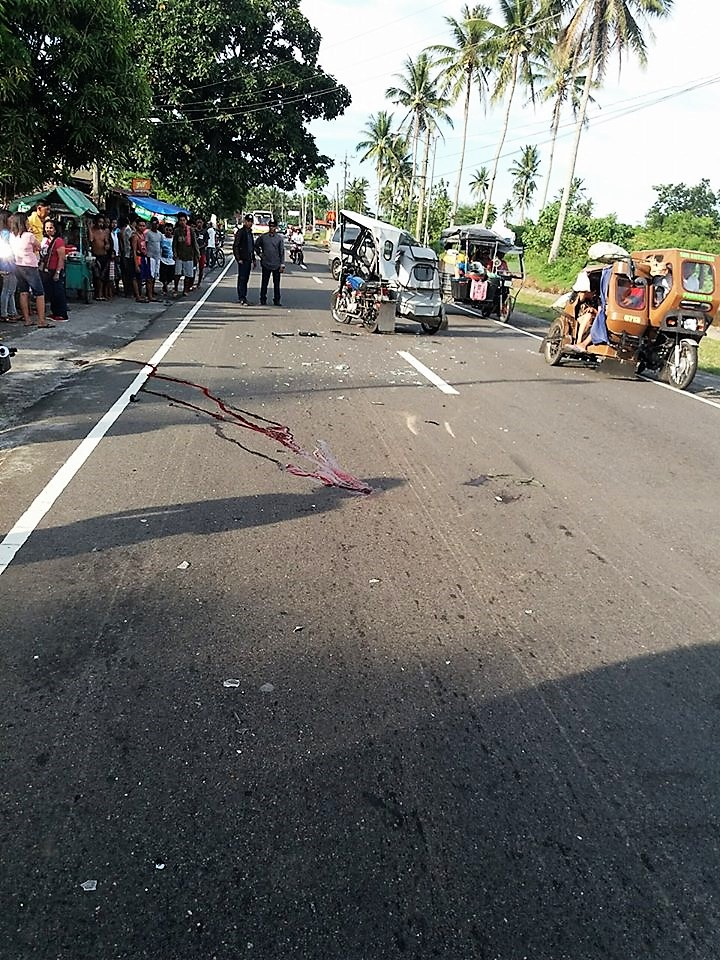Another Blood Spilled on the Road Again. A tragic scene of the aftermath of van-tricycle collision along the national highway in Purok 1, Barangay San Antonio, Tabaco City. Photo by Erwin C. Tumala.