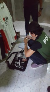 A PDEA agent performs inventories of searched illegal drugs items. PDEA photo.